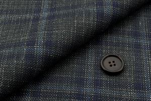 [オーダーレディーススーツ スカートセット]独特な色合いのチェック柄であなたの個性が引き立つ